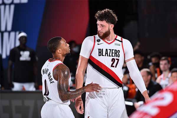 NBA常规赛开拓者124比121击败76人